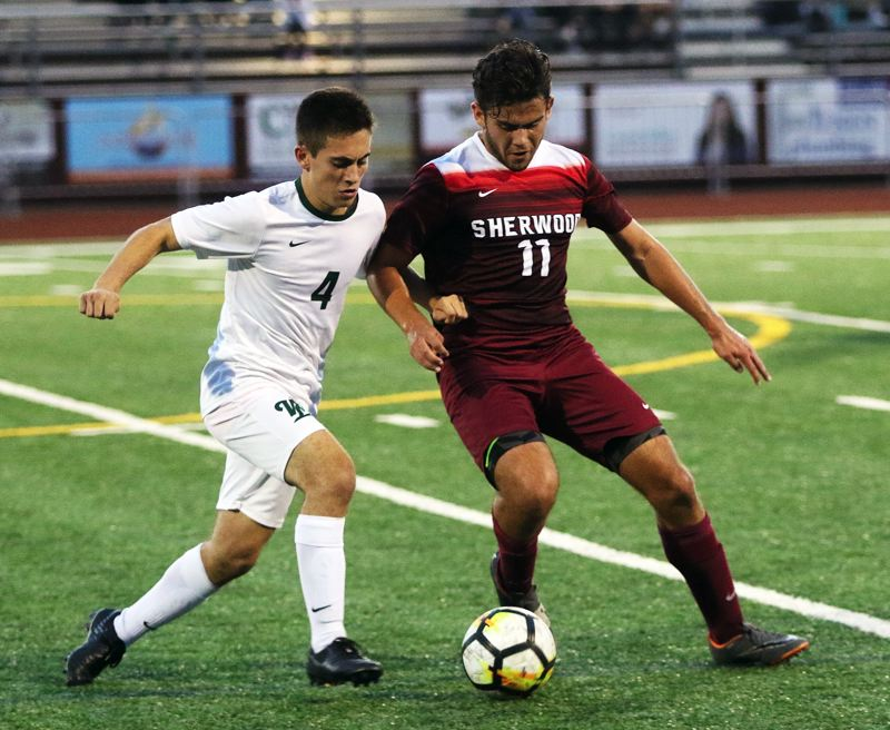 TIMES PHOTO: DAN BROOD - Sherwood High School senior forward Micah Muller (right) was a second-team All-Pacific Conference selection.