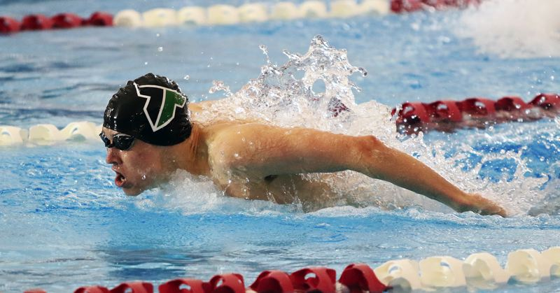 TIMES FILE PHOTO: DAN BROOD - Ben Miller is back for his senior season at Tigard after placing second in the 100 butterfly at state last year.