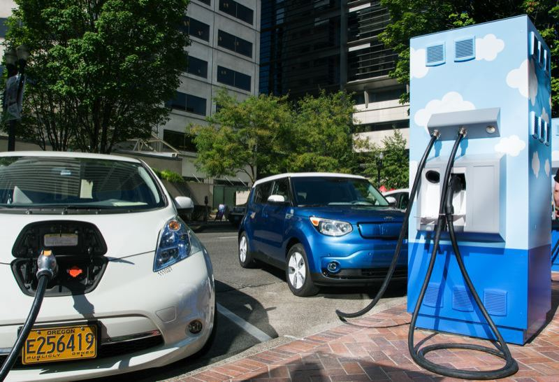 PORTLAND TRIBUNE FILE PHOTO - Electrric vehilces being recharged at Electric Avenue near the downtown Portland PGE headquarters.