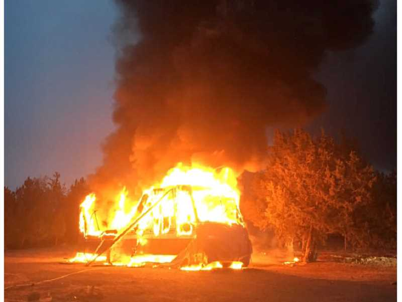 SUBMITTED PHOTO - A motor home went up in flames early on Nov. 21, near a residence southeast of Madras.