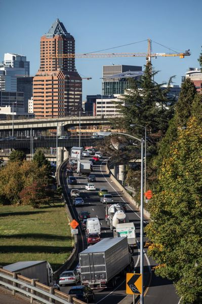 PORTLAND TRIBUNE: JON HOUSE - Cars and trucks driving on I-5 North, passing under the Ross Island Bridge, on a portion of the freeway where tolls are being considered.