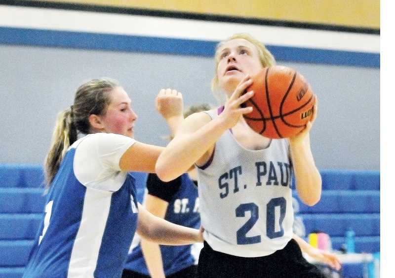 GARY ALLEN - Bucks post Isabelle Wyss attacks the basket during a practice last week at St. Paul High School.