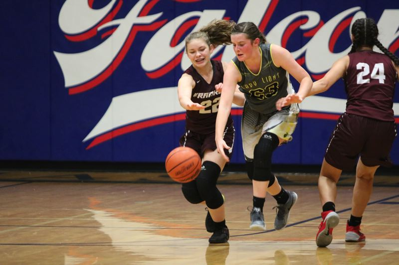 PAMPLIN MEDIA GROUP PHOTO: JIM BESEDA - Kaela Lee (center) of St. Helens High steals the ball from Franklins Shaydee Gunnell during a season-opening jamboree Wednesday night at La Salle Prep.