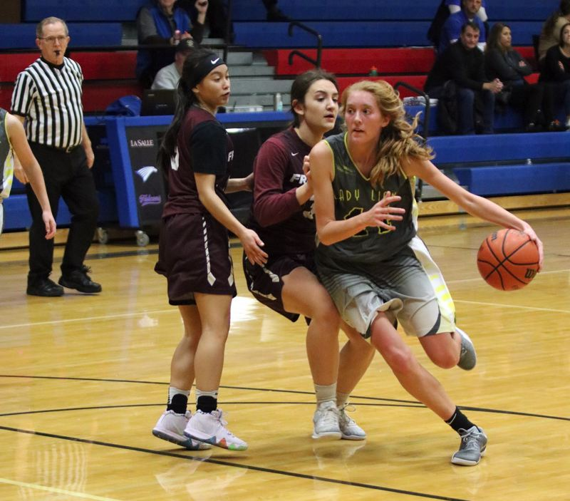 PAMPLIN MEDIA GROUP PHOTO: JIM BESEDA - Maddie Holm (44) of St. Helens drives around Franklin's Christy Nguyen (left) and Carmen Fiarito during Wednesday's 12-minute jamboree clash at La Salle Prep.