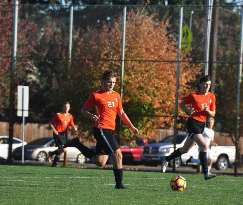 COURTESY: LYNN BOYLE  - Scappoose High junior midfielder Corbin Edson pushes the ball up the field in a 2018 game.