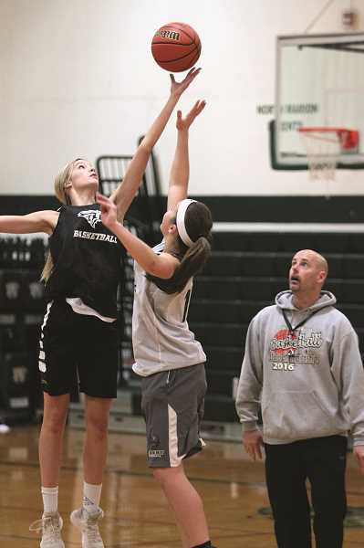 PHIL HAWKINS - North Marion junior Katie Ensign rises up to snatch the opening tip of practice prior to the beginning of the 2018-19 girls basketball season.