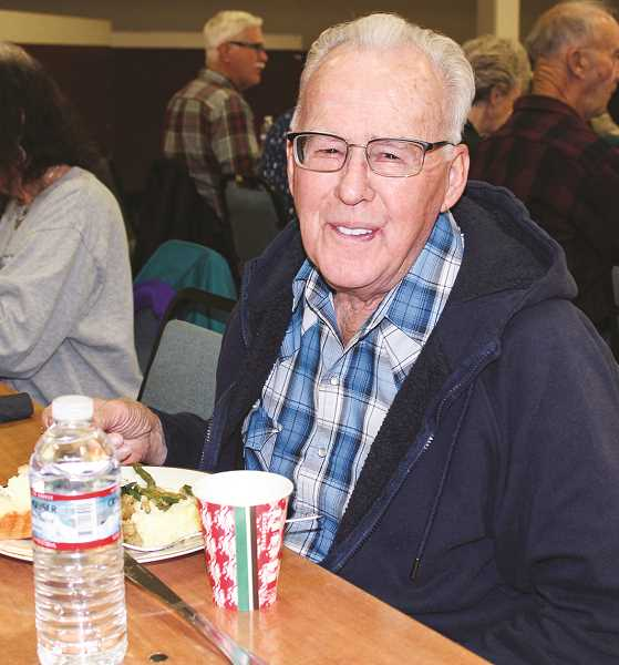 HOLLY SCHOLZ/CENTRAL OREGONIAN  - Wayne Lindberg, of Prineville, enjoys his traditional Thanksgiving meal during the Veterans Appreciation Dinner. He served in the U.S. Army from 1957 to 1962.
