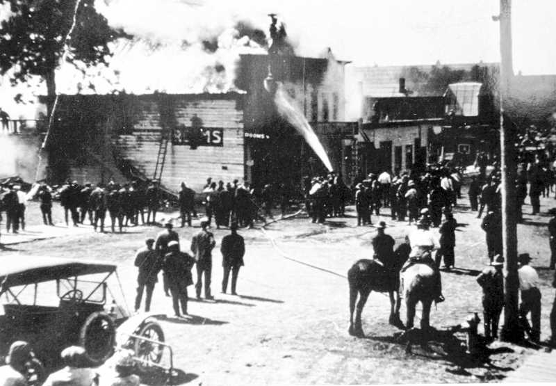 PHOTO COURTESY OF BOWMAN MUSEUM  - O'Kane's Saloon caught fire in Bend in the early morning hours of April 27, 1905. Surrounding buildings were saved, but the saloon was destroyed.