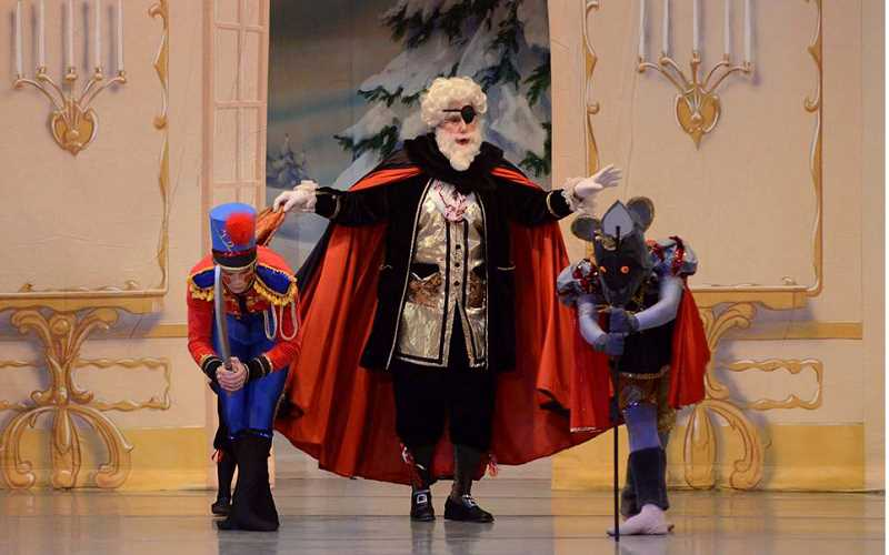 SUBMITTED PHOTO - Margee O'Brien, center, plays Herr Drosselmeyer in the Nutcracker ballet.