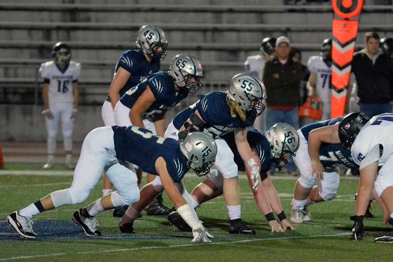 SPOKESMAN PHOTO: TANNER RUSS - The Wilsonville defense gets lined up against the Ridgeview Ravens in the opening round of the stateplayoffs. The defensive unit recorded 909 tackles over the 13 game season, along with 33 total sacks.