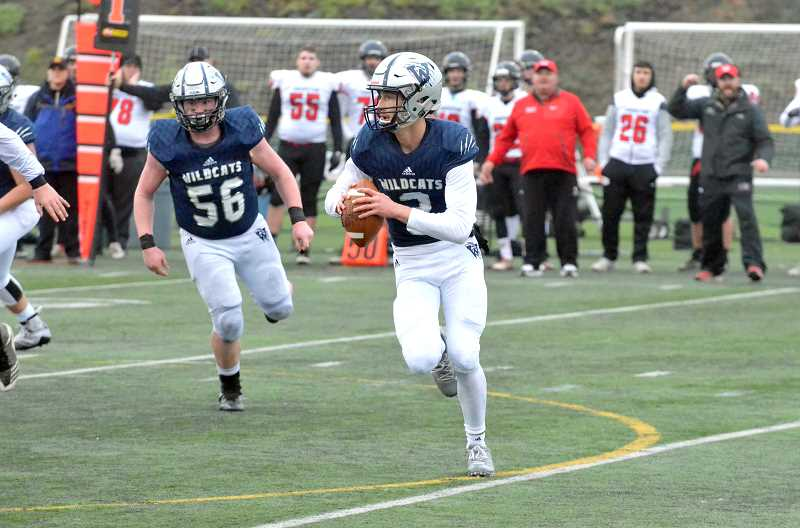 SPOKESMAN PHOTO: TANNER RUSS - Wilsonville quarterback Nathan Overholt scrambles out of the pocket against the Thurston defense in his record setting game.