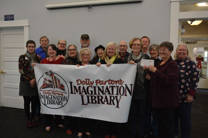 SPOTLIGHT PHOTO: COURTNEY VAUGHN - Members of United Way of Columbia County, along with the St. Helens Daybreakers Kiwanis Club, Scappoose Library and Columbia County, gather to celebrate the successful upstart of the Dolly Parton Imagination Library.