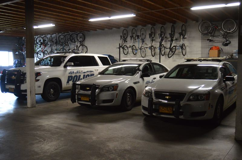 SPOTLIGHT PHOTO: NICOLE THILL-PACHECO - St. Helens Police Department vehicles sit inside the police station garage. The department will start getting new vehicles next year thanks to a fleet management lease program the city has signed up for.