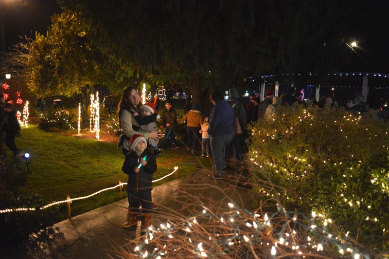 SPOTLIGHT PHOTO: COURTNEY VAUGHN - The Bates family checks out holiday lights in Heritage Park. Pictured: Owen, 4, Mabel, 9 months and mom, Ashley Bates.