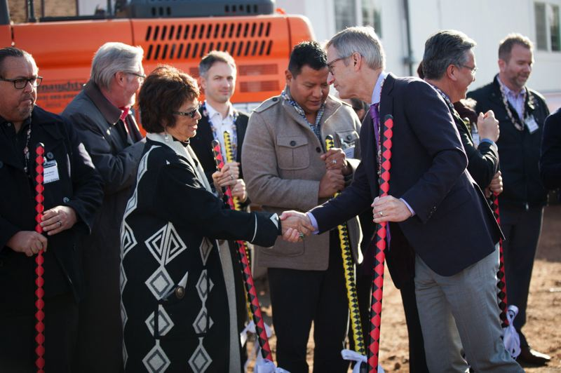 PAMPLIN MEDIA GROUP: JAIME VALDEZ - Delores Pigsley, left, chairman of the Confederated Tribes of Siletz Indians, and Portland Mayor Ted Wheeler were among those who turned out to attend a groundbreaking for Nesikia Illahee. The afforable housing development in the Cully neighborhood will include 20 units reserved for members enrolled in federally recognized tribes.