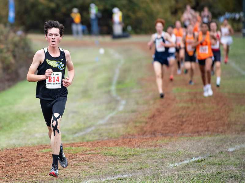LON AUSTIN/CENTRAL OREGONIAN - Cade Catterson leads a group of runners as they near the end of the state cross country championships. Catterson, who finished 10th individually, helped lead the Cowboys to a second-place finish.