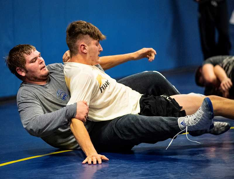 LON AUSTIN/CENTRAL OREGONIAN - Crook County heavyweight Caleb Parrott (grey shirt) looks to control 195-pounder Jaxson Rhoden during a recent practice. Parrott and Rhoden are both seniors. Rhoden was second at last year's state championships and is currently rated No. 1 in the state, while Parrott, who was fourth at last year's state tournament, is also ranked No. 1 heading into the season.