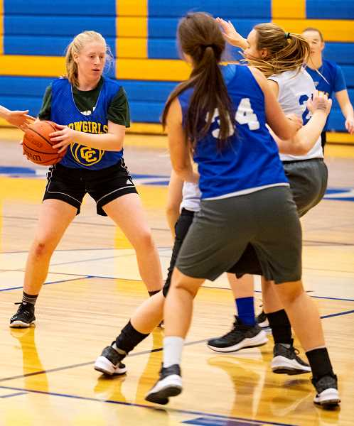 LON AUSTIN/CENTRAL OREGONIAN - Heather Ptomey looks to go to the basket during a recent practice, while Liz Barker (34) sets a screen. Ptomey is one of just three seniors on the Cowgirl roster.