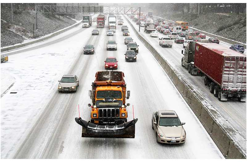 PMG FILE PHOTO - Salting trucks plied many of Oregon's highways last year as the region saw ner-record snowfall.