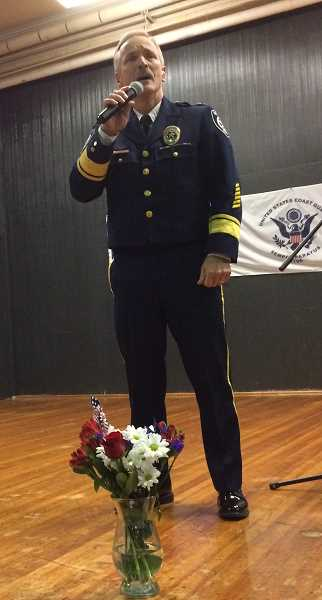 PIONEER PHOTO: CAROL ROSEN - Police Chief Rod Lucich sings at the Veterans Day assembly.