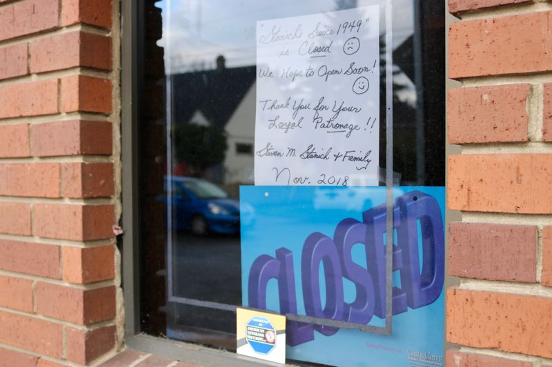 TRIBUNE PHOTO: ZANE SPARLING - A sign in the window of Stanich's dated Nov. 2018 says the restaurant in Northeast Portland plans to reopen soon.