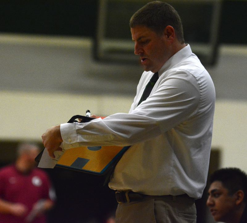 OUTLOOK PHOTO: DAVID BALL - Reynolds coach Ted Aubin draws up a play during a break in the action.