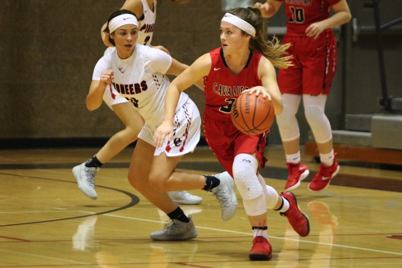 PAMPLIN MEDIA: JIM BESEDA - Oregon City's point guard Tyra Bradford (left) puts pressure on Clackamas' Olivia Morris during the first half of the Pioneers' season-opening 66-25 win over Clackamas at Oregon City High School.