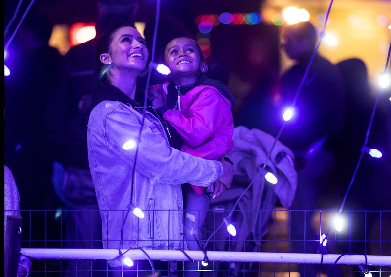 TIMES PHOTO: JONATHAN HOUSE - Shima Lotfi and her daughter Aara Cox check out the lights Friday night, Nov. 30, during the Christmas tree-lighting at Beaverton City Park.