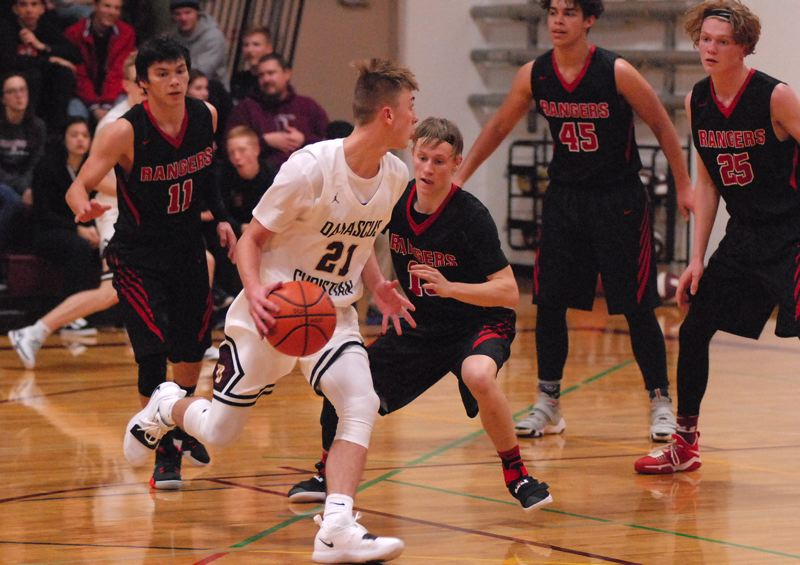 OUTLOOK PHOTO: DAVID BALL - Damascus Christians Jason Budey turns and finds a wall of defenders during the second half of the Eagles 47-41 win over Dufur on Friday night.