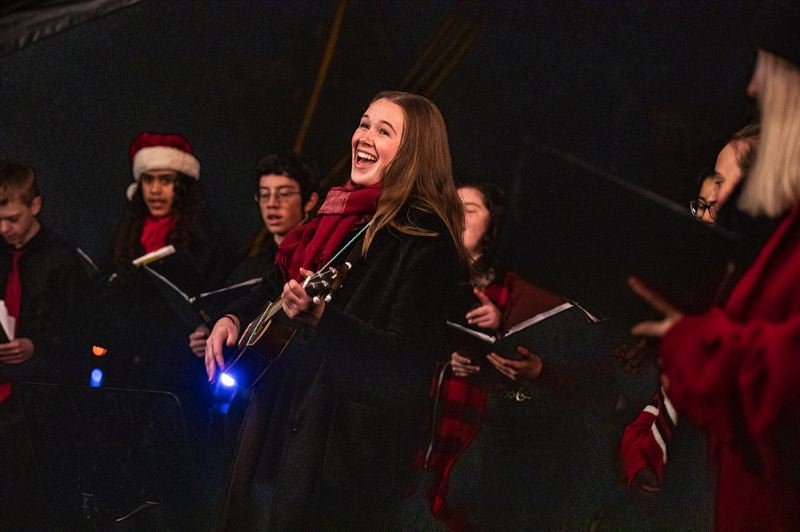 TIMES PHOTO: JONATHAN HOUSE - Ava Ivy performs on the ukulele with the Synergy choir from the Arts and Communication Magnet Academy on Friday night, Nov. 30, at the Christmas tree-lighting at Beaverton City Park.