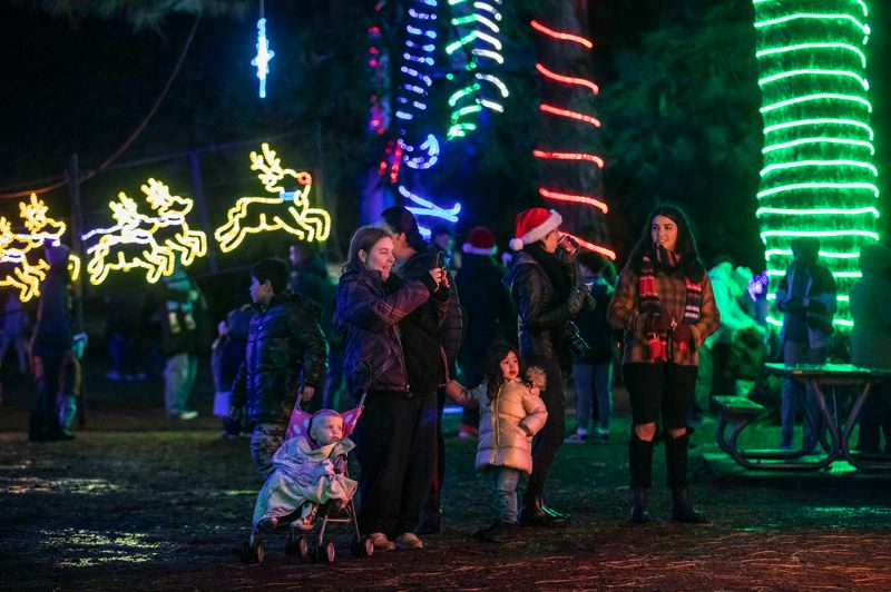 TIMES PHOTO: JONATHAN HOUSE - Crowds enjoy the light show Friday night, Nov. 30, at the Christmas tree-lighting at Beaverton City Park.