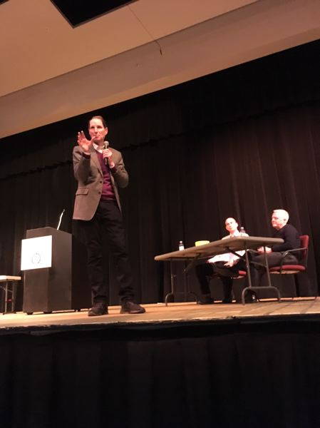 PAMPLIN MEDIA GROUP: PETER WONG - U.S. Sen. Ron Wyden, D-Ore., makes a point during a town hall meeting Saturday, Dec. 1, at Rex Putnam High School in Milwaukie. Seated are Principal Ryan Richardson and Matt Utterback, superintendent of North Clackamas schools.