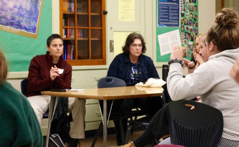TRIBUNE PHOTO: ZANE SPARLING - Capt. Tashia Hager, in red, listens to feedback from students during a leadership summit at Cleveland High School on Saturday, Dec. 1.