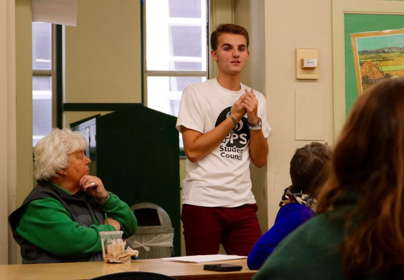 TRIBUNE PHOTO: ZANE SPARLING - Nick Paesler speaks with peers during a district-wide leadership summit at Cleveland High School on Saturday, Dec. 1.