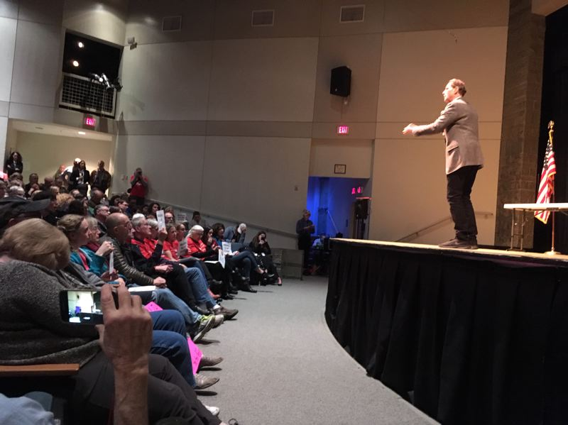 PAMPLIN MEDIA GROUP: PETER WONG - U.S. Sen. Ron Wyden, D-Ore., speaks at a town hall meeting Saturday, Dec. 1, at Rex Putnam High School in Milwaukie. He opened his 912th town hall since taking office in 1996 with a short tribute to George H.W. Bush, the former president who died the previous day at age 94.