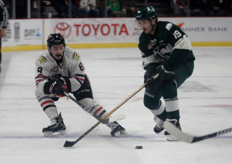 TRIBUNE PHOTO: JONATHAN HOUSE - Cody Glass (left) of the Portland Winterhawks works against the Everett Silvertips' Bryce Kindopp.