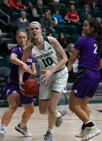TRIBUNE PHOTO: JONATHAN HOUSE - Courtney West of Portland State tries to get past the University of Portland defense during last week's matchup at Viking Pavilion.