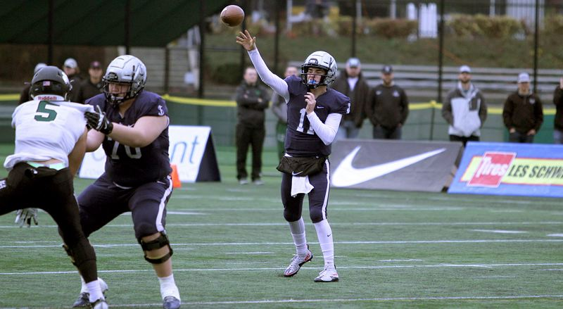 REVIEW PHOTO: MILES VANCE - Lake Oswego senior quarterback Jackson Laurent finished his high school football career with a flourish, helping lead the Lakers to a 34-27 win over Sheldon in the Class 6A state championship game on Saturday at Hillsboro Stadium.