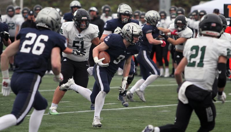 REVIEW PHOTO: MILES VANCE - Lake Oswego junior running back Casey Filkins left Sheldon behind for most of the day on Saturday, racking up 167 yards in total offense and scoring five touchdowns.