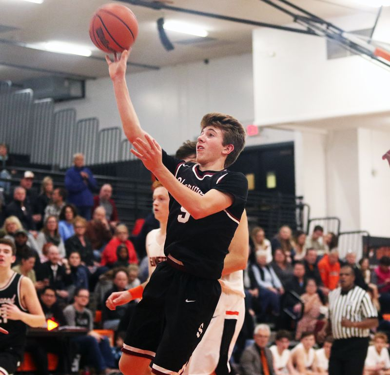 TIMES PHOTO: DAN BROOD - Sherwood sophomore Asher Krauel goes up to the basket for two of his game-high 17 points in the Bowmen's 64-56 win at Beaverton.
