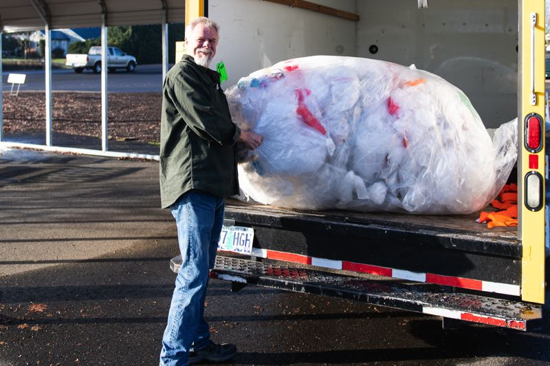 STAFF PHOTO: CHRISTOPHER OERTELL - Once every week, Jim Hogan of Murphy's Furniture delivers a large bag of plastic to Brookwood Elementary School for a recycling program there.