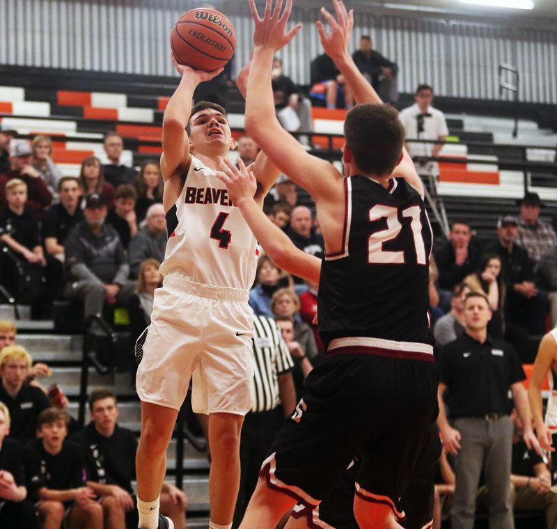 TIMES PHOTO: DAN BROOD - Beaverton senior Isaac Rosenthal (4) looks to shoot over Sherwood senior Braden Thorn during Friday's game.