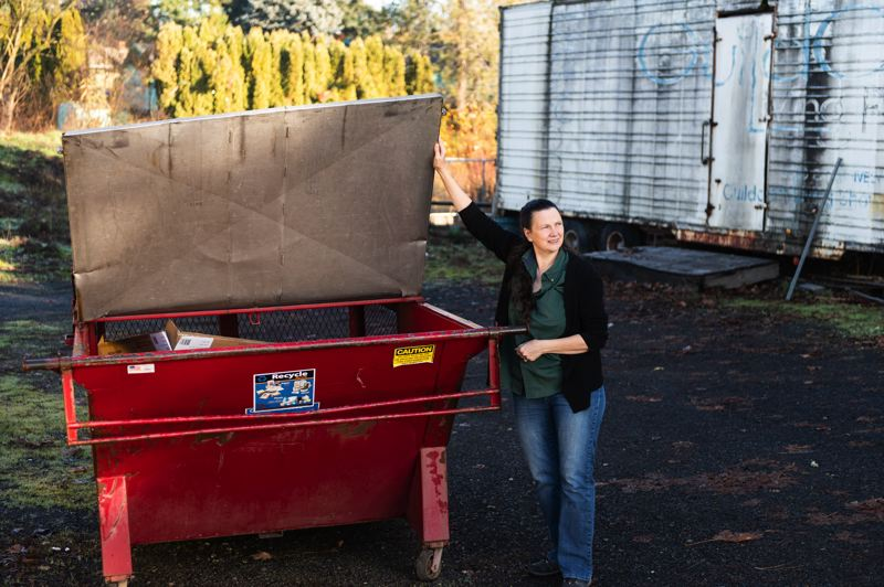 STAFF PHOTO: CHRISTOPHER OERTELL - Kathy Murphy-Hogan, president of Murphy's Furniture, shows off the cardboard dumpster that is filled and emptied thrice per week outside her Cornelius store.