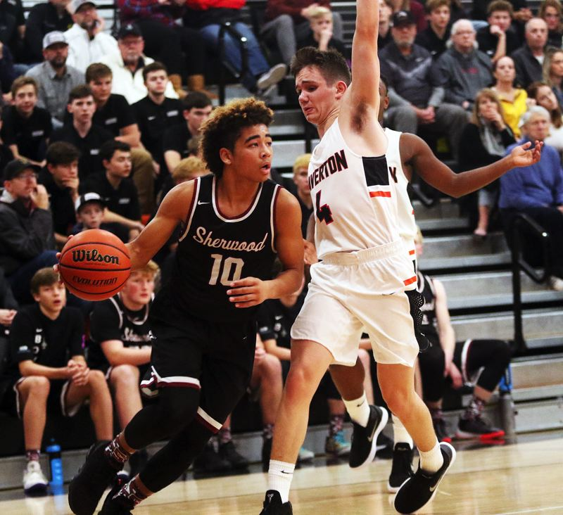 TIMES PHOTO: DAN BROOD - Sherwood senior guard Jamison Guerra (left) looks to drive past Beaverton's Isaac Rosenthal during Friday's game.