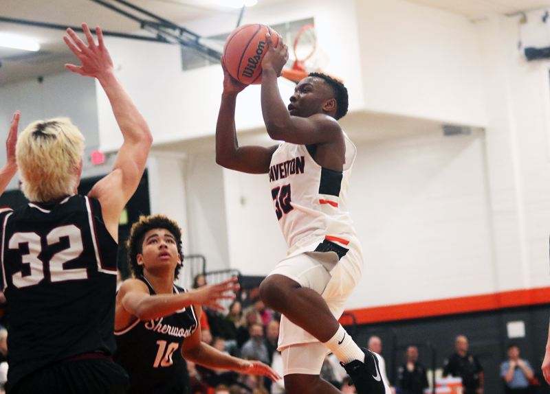 TIMES PHOTO: DAN BROOD - Beaverton sophomore Ams Juwara (right) goes up to take a shot during the Beavers' game with Sherwood on Friday.