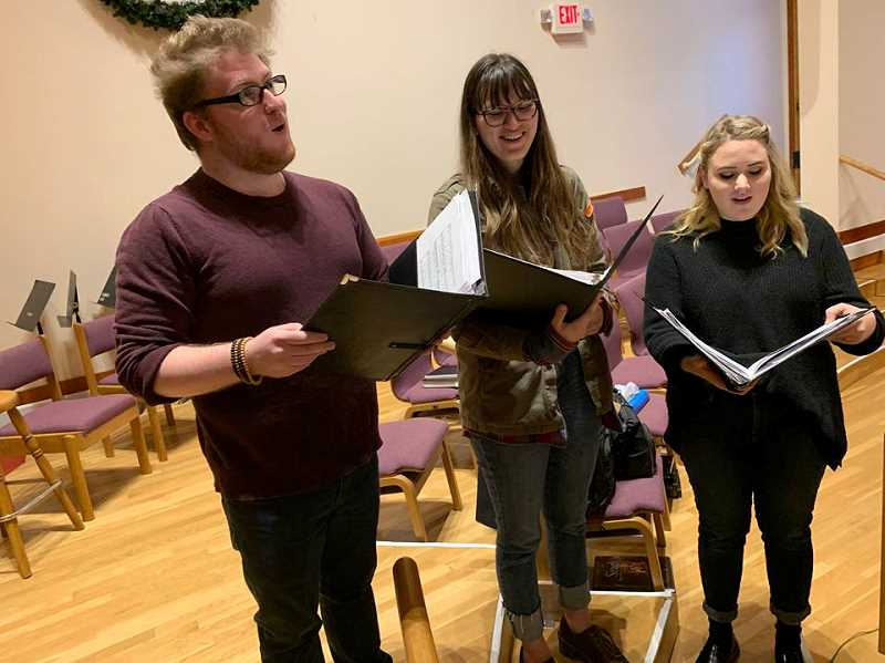 STAFF PHOTO: JANAE EASLON - Pacific University students Dwight Collins, Zoë Kim-Maskell and Kaitlin Gilbert perform sections of Handel's 'Messiah' in preperation for Sunday, Dec. 9.