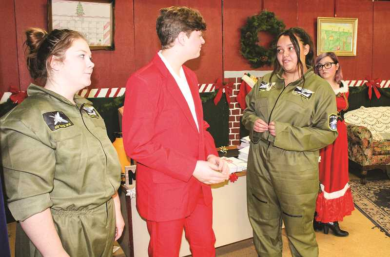 HOLLY SCHOLZ/CENTRAL OREGONIAN  - From left, Morgan Whitten (as Bill), Wylee Chavez (as Buddy), Catalina Ortez (as Bob) and Susan Williams (as Mrs. Claus) discuss an upcoming holiday party. Bill and Bob are from the North Pole's Communication and Navigation Department.