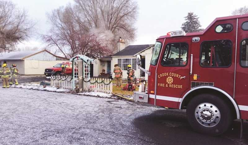 PHOTO COURTESY OF CROOK COUNTY FIRE AND RESCUE - Crook County Fire and Rescue personnel respond to a garage fire on Sunday morning that spread to the attic.