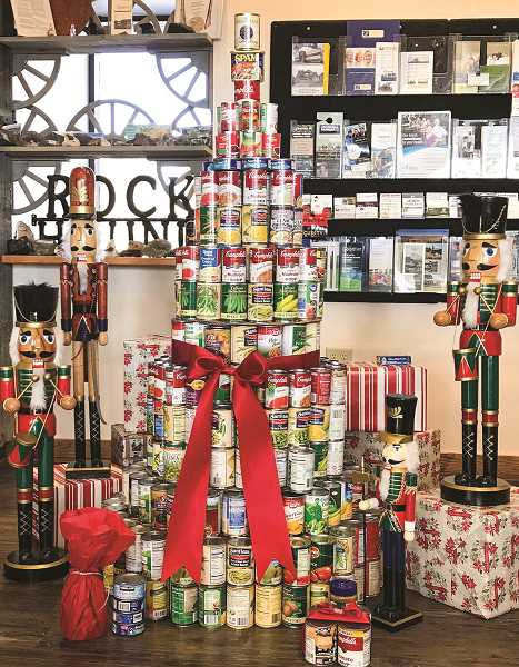 PHOTO CONTRIBUTED BY CHAMBER OF COMMERCE  - Food donations collected through the Charm Trail will be given to the Holiday Partnership to support families with children, senior and disabled citizens in Crook County in need of food baskets.