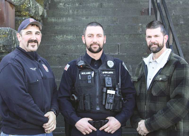 JASON CHANEY - The No Shave November winners from each emergency service department pose for a photo on the Crook County Courthouse steps. Pictured left to right are Martin Theurer of Crook County Fire and Rescue, Brandin Noland with Prineville Police Department, and Keith Knight with Crook County Sheriff's Office.